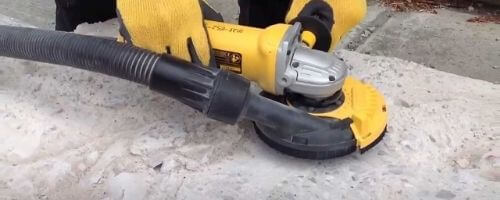 grinding concrete floor with hand grinder